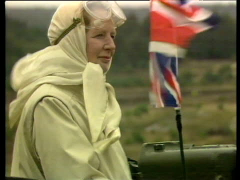 prime minister margaret thatcher sitting in challenger tank with union flag fluttering alongside whilst on visit to see military manoeuvres at... - kampfpanzer stock-videos und b-roll-filmmaterial