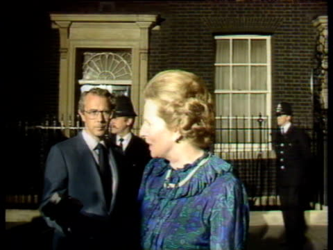 Prime Minister Margaret Thatcher talks to press outside No 10 following announcement of Argentine surrender in Falklands conflict as crowds sing...