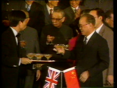 prime minister margaret thatcher toasts chairman deng xiaoping with champagne following signing of sinobritish declaration agreeing handover of hong... - leitende person stock-videos und b-roll-filmmaterial