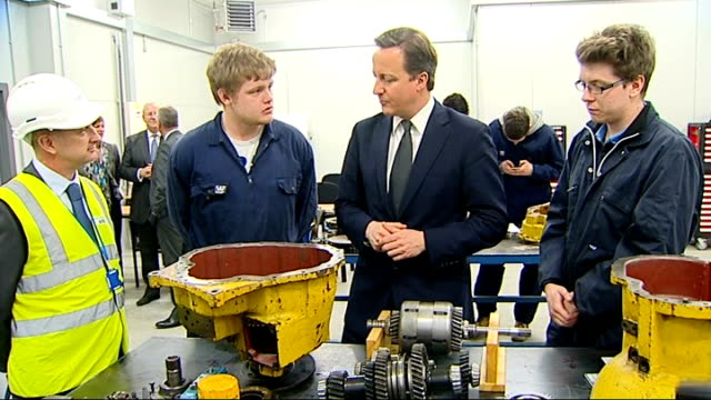 Prime Minister meets apprentices and speech ENGLAND Essex Ilford INT Various of Prime Minister David Cameron MP chatting with apprentices working on...