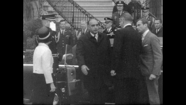 Prime Minister Mohammed Hashim Maiwandwal arrives at White House / military guard stands by while small crowd watches as Prime Minister Mohammed...