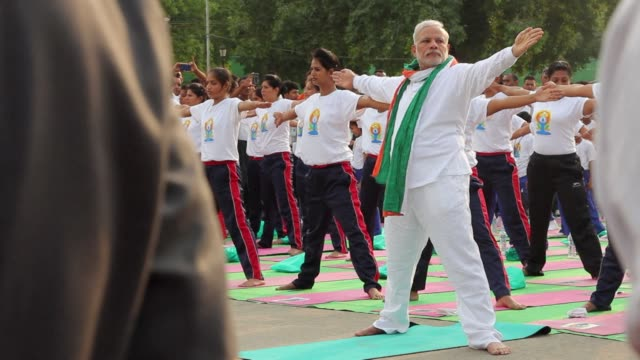Prime Minister Narendra Modi hails the first International Yoga Day as a new era of peace and surprises thousands in New Delhi by taking to a mat...