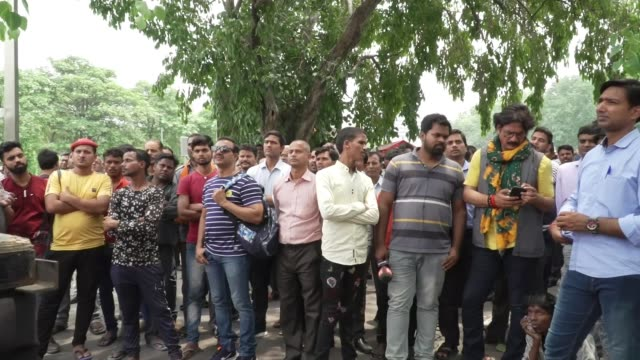 Prime Minister Narendra Modi wins landslide victory in general election INDIA Delhi EXT Various of crowds gathered to watch video screen displaying...