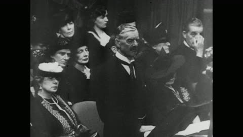 """prime minister neville chamberlain tells parliament that britain will go to war if hitler invades poland. a quote appears on the screen: """"democracy... - poland stock videos & royalty-free footage"""