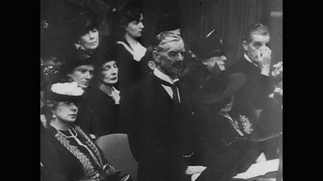 "prime minister neville chamberlain tells parliament that britain will go to war if hitler invades poland. a quote appears on the screen: ""democracy... - 1943 stock-videos und b-roll-filmmaterial"