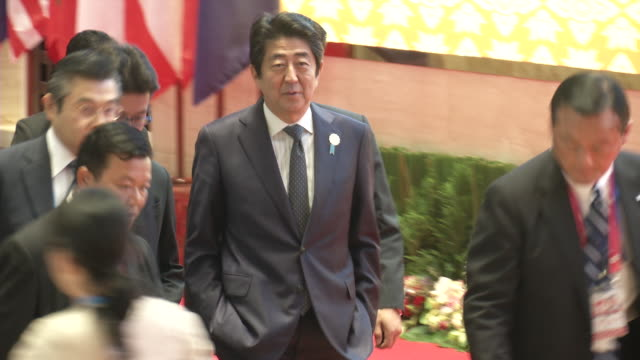 prime minister of japan shinzō abe, walks to a meeting during the association of southeast asian nations summit the laotian capital vientiane. - association of southeast asian nations stock videos & royalty-free footage
