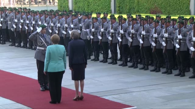 Prime Minister of the United Kingdom Theresa May is welcomed by German Chancellor Angela Merkel during the official welcoming ceremony at German...