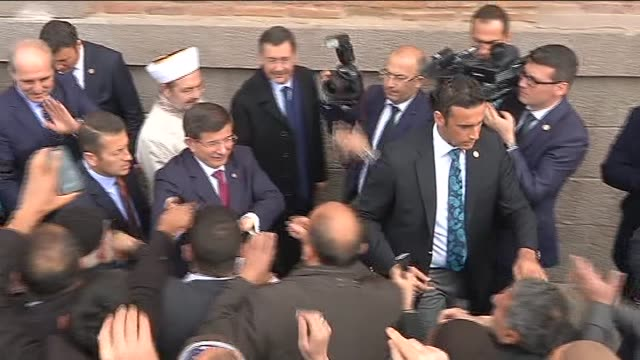 prime minister of turkey ahmet davutoglu is greeted by supporters as he visits and performs friday prayer at haci bayram-i veli mosque in ankara,... - freitag stock-videos und b-roll-filmmaterial