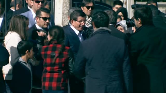 prime minister of turkey ahmet davutoglu poses next to his wife sare davutoglu as he casts his ballot in the turkey's 26th general election at a... - konya stock videos and b-roll footage