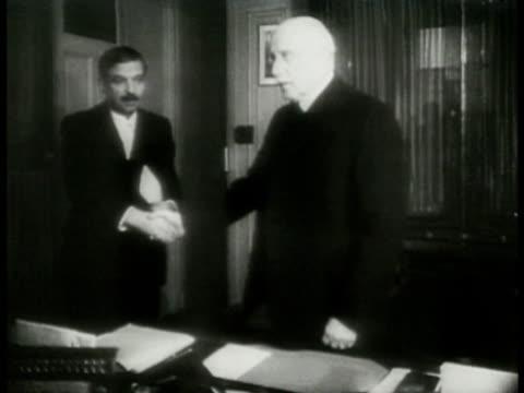 prime minister pierre laval shaking hands talking w/ head of state henri-philippe petain henri-philippe petain speaking . pierre laval speaking both... - ナチスかぎ十字点の映像素材/bロール