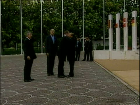prime minister silvio berlusconi gives prime minister tony blair three kisses at entrance to eu summit rome 04 oct 03 - global communications stock videos & royalty-free footage