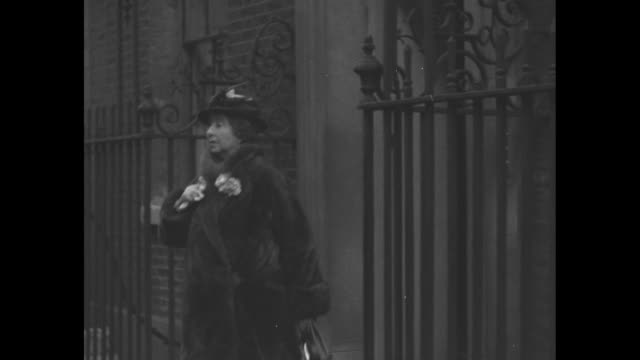 vs prime minister stanley baldwin and wife lucy leave 10 downing street and enter a polished rolls royce / note exact month/day not known - downing street video stock e b–roll