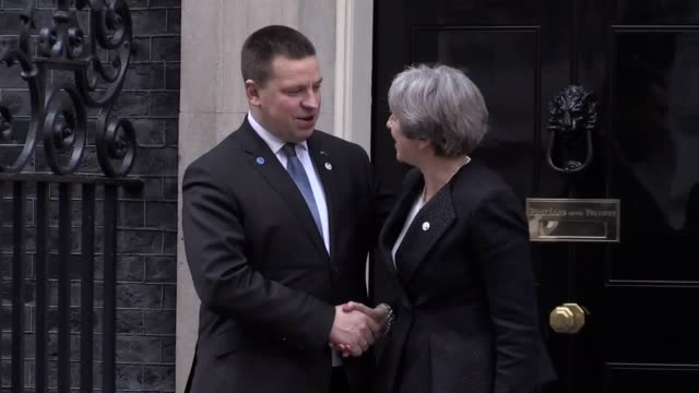 Prime Minister Theresa May and Estonian Prime Minister Juri Ratas shake hands outside 10 Downing Street in London