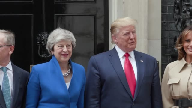 prime minister theresa may and philip may welcome us president donald trump and first lady melania trump to downing street london on the second day... - visit stock videos & royalty-free footage