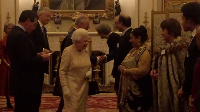 Prime Minister Theresa May and the Prince of Wales have all made an unannounced appearance at a Buckingham Palace reception hosted by the Queen...
