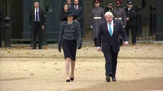 prime minister theresa may and uk foreign secretary boris johnson arrive at horse guards parade ahead of the ceremonial welcome for the colombian... - horse guards parade stock videos and b-roll footage