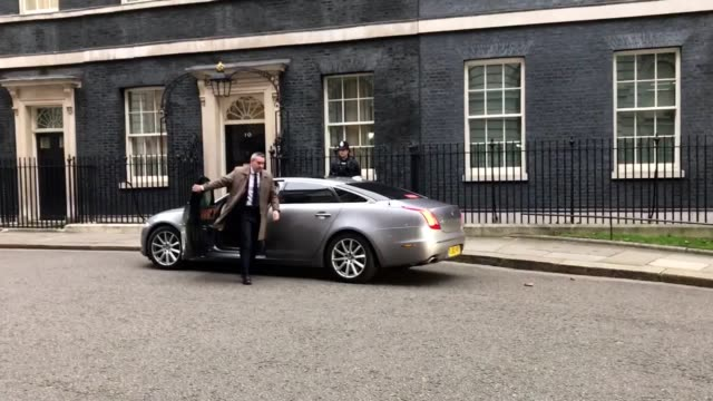 prime minister theresa may arrives at 10 downing street ahead of the most extensive reshuffle of her top team since she appointed her first cabinet... - downing street stock-videos und b-roll-filmmaterial