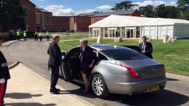 prime minister theresa may arrives at the unveiling of the new defence and national rehabilitation centre at stanford hall in nottinghamshire - theresa may stock-videos und b-roll-filmmaterial