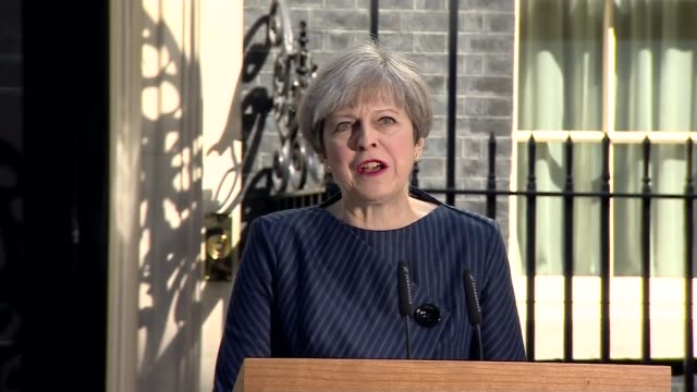 Prime Minister Theresa May calls General Election Downing Street Theresa May MP departing Number 10 and along to podium Theresa May MP making...