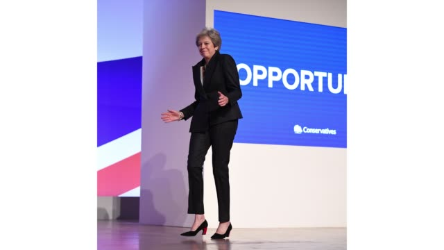 prime minister theresa may dances on stage at conservative party leader speaks to conference on day four on october 3 2018 in birmingham england... - theresa may stock videos & royalty-free footage