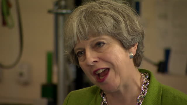 prime minister theresa may discusses the conservative manifesto on the lead up to the election on june 8th - 安定点の映像素材/bロール