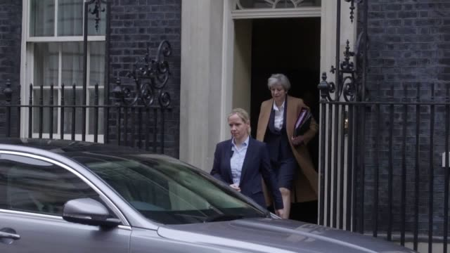 prime minister theresa may leaves 10 downing street london ahead of prime minister's questions - prime minister's questions stock videos & royalty-free footage