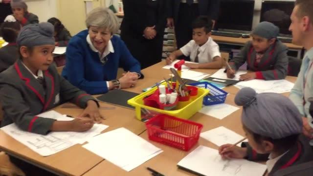 prime minister theresa may meets schoolchildren at nishkam primary school in handsworth, birmingham. - handsworth stock videos & royalty-free footage