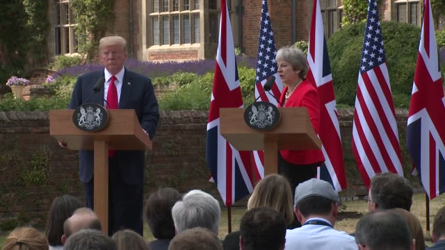 prime minister theresa may reiterates her points on germany and brexit before leaving the stage with president donald trump on july 13 2018 in... - donald trump us president stock videos and b-roll footage