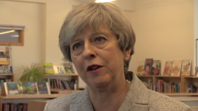 prime minister theresa may talks about the latest on the combustible cladding investigation during a visit to orchard school bristol in bristol. - may stock videos & royalty-free footage