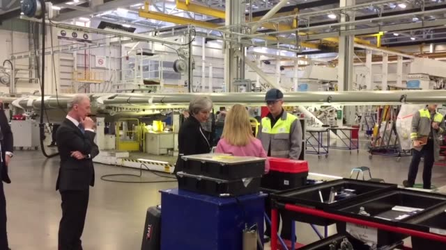 prime minister theresa may tours the bombardier factory in belfast before meeting with the main political parties at stormont - stormont stock videos and b-roll footage