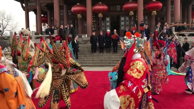 Prime Minister Theresa May watches a Chinese opera in the Chinese city of Wuhan looks out over the Yangtze River and visits University in Hubei May...