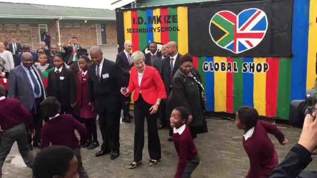 prime minister theresa may watches pupils dance at id mkize senior secondary school in south africa on her trip to africa - theresa may stock videos & royalty-free footage