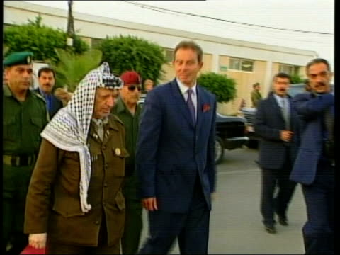ms prime minister tony blair along red carpet with palestinian leader yasser arafat pan - haifa stock videos and b-roll footage