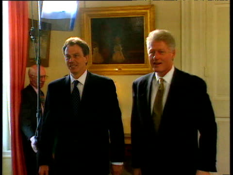 Prime Minister Tony Blair and President Bill Clinton walk together smiling through No 10 Downing Street London 29 May 97
