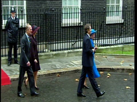 prime minister tony blair and queen elizabeth ii followed by cherie blair and prince philip walking down downing street 20 nov 97 - politik und regierung stock-videos und b-roll-filmmaterial