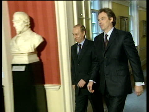 prime minister tony blair and russian president vladimir putin walking down corridor in 10 downing street blair introduces putin to two colleagues... - colleague stock videos & royalty-free footage
