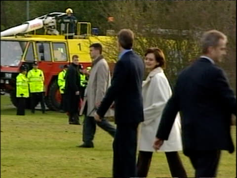 prime minister tony blair and wife cherie greet president george w bush and wife laura as they exit helicopter nov 03 - global communications stock videos & royalty-free footage