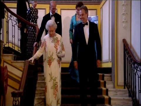 prime minister tony blair descends stairs during g8 summit with queen elizabeth ii duke of edinburgh and cherie blair behind them gleneagles hotel... - tony blair stock-videos und b-roll-filmmaterial