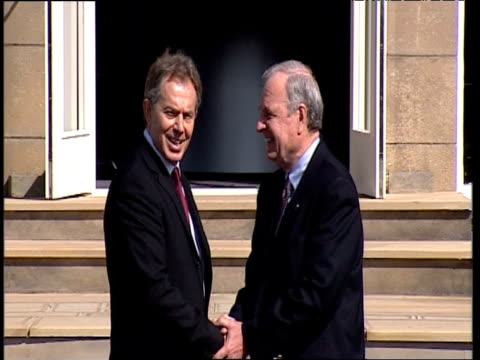 prime minister tony blair greets and shakes hands with canadian prime minister paul martin at g8 summit outside gleneagles hotel scotland 07 jul 05 - government minister stock videos & royalty-free footage