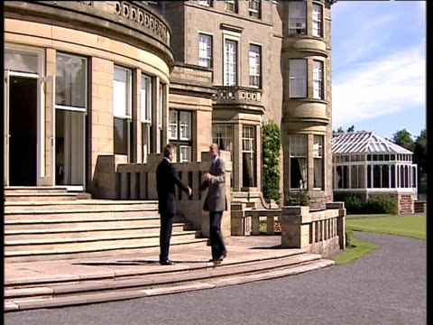 prime minister tony blair greets and shakes hands with french president jacques chirac prior to commencement of g8 summit gleneagles 07 jul 05 - g8 summit stock videos & royalty-free footage