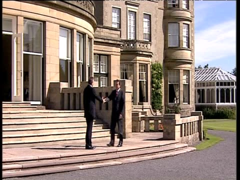 prime minister tony blair greets and shakes hands with german chancellor gerhard schroeder prior to commencement of g8 summit gleneagles 07 jul 05 - g8 summit stock videos & royalty-free footage