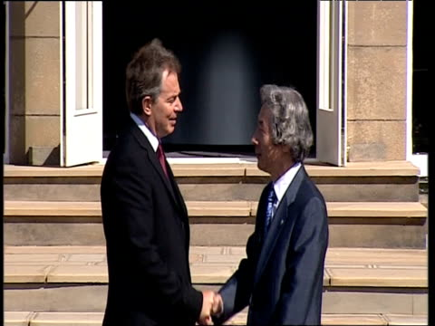 prime minister tony blair greets and shakes hands with japanese prime minister junichiro koizumi prior to commencement of g8 summit gleneagles 07 jul... - g8 summit stock videos & royalty-free footage