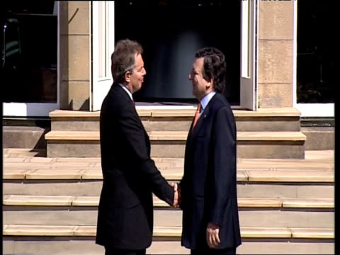 prime minister tony blair greets and shakes hands with president of european commission jose manuel barroso at g8 summit outside gleneagles hotel... - g8 summit stock videos & royalty-free footage