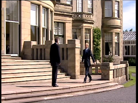 prime minister tony blair greets and shakes hands with russian president vladimir putin prior to commencement of g8 summit gleneagles 07 jul 05 - g8 summit stock videos & royalty-free footage