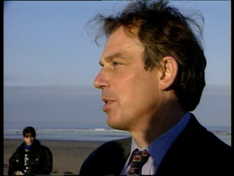 prime minister tony blair standing on beach comments on lockerbie trial - tony blair stock-videos und b-roll-filmmaterial