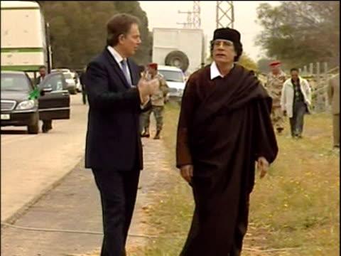 prime minister tony blair talks about his historic meeting with colonel muammar gaddafi shots of handshake spectators and blair at podium libya 25... - muammar gaddafi stock videos & royalty-free footage