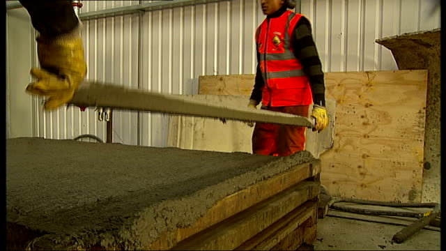 prime minister visits apprentices working on crossrail project england london ext jeremiah white helping spread out cement as being poured into mould... - ear protectors stock videos and b-roll footage