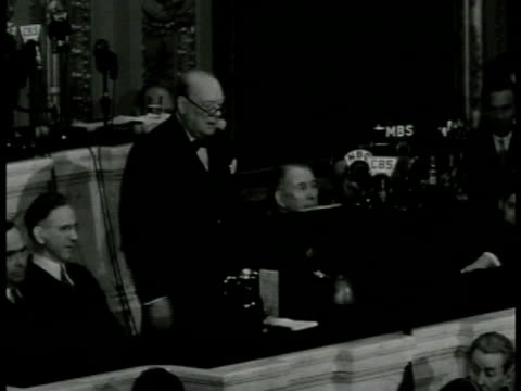 prime minister winston churchill behind podium saying after conference w/ president became evident'defeat of germany would infallibly mean the ruin... - 1943 stock-videos und b-roll-filmmaterial