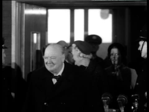 prime minister winston churchill entering arrivals hall to greet press at southampton docks jan 53 - politik und regierung stock-videos und b-roll-filmmaterial