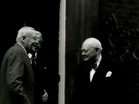 Prime Minister Winston Churchill Foreign Secretary Anthony Eden and US Foreign Secretary John Dulles walk out of Ten Downing Street and pose for...